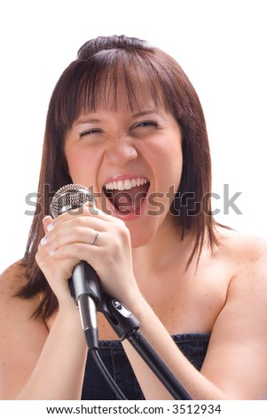 Girl singing with a mic isolated in white background