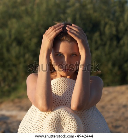 girl sit with hat in hands - stock photo