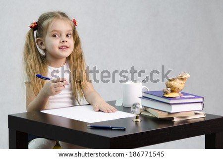 girl sits at a table and flips through book and writes out information you need. Next are still books, sheets of paper, a pen, a glass of tea. image of student, a pupil, a teacher and literary critic