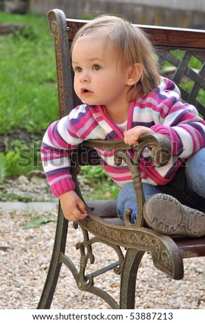 girl sits on bench - stock photo
