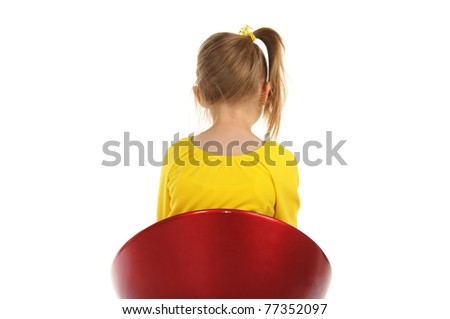 Girl sits on chair back to camera isolated in white - stock photo