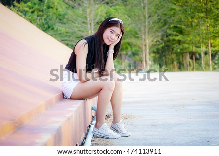 girl sitting against the wall and prop up