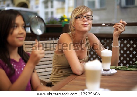 girl sitting at table with drinking