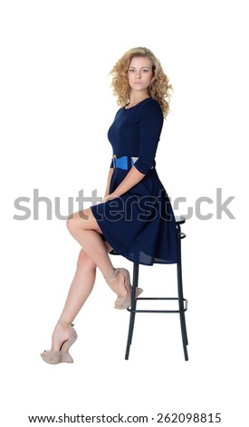 Girl sitting, bar stool, blonde, studio, dress - stock photo