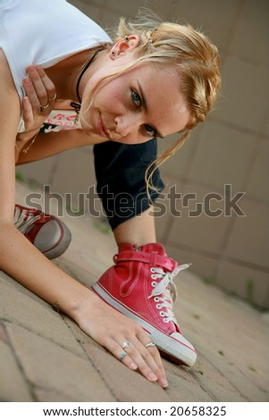 Girl sitting down looking at camera - stock photo