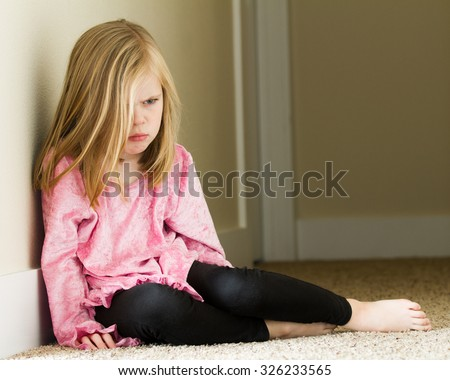Girl sitting down upset and having a bad day - stock photo