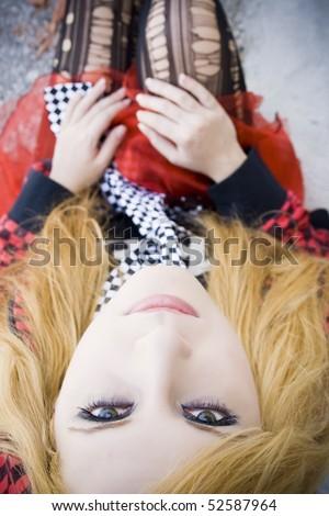 girl sitting facing the camera - stock photo