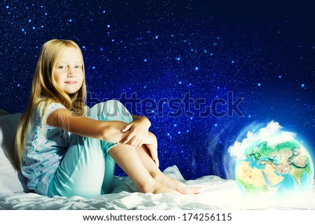 Girl sitting in bed and dreaming. Elements of this image are furnished by NASA