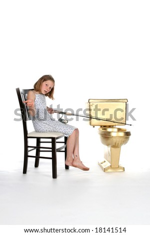 girl sitting in chair and fishing in gold toilet
