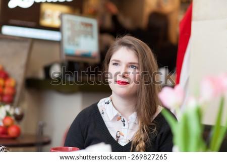 girl sitting in coffee shop  - stock photo