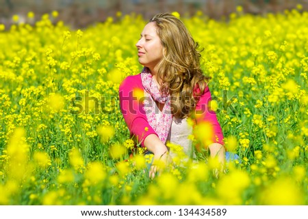 Girl sitting in flowers in Napa, California, USA - stock photo