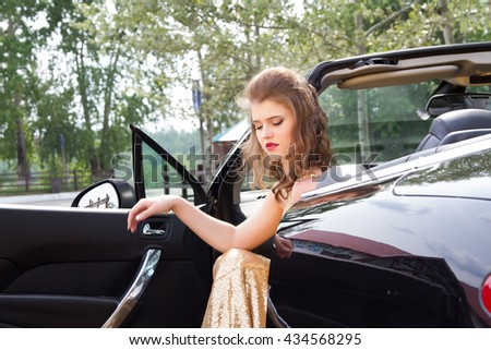 Girl sitting in the driver's seat in a convertible