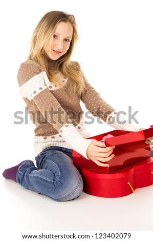 girl sitting near gift boxes - stock photo