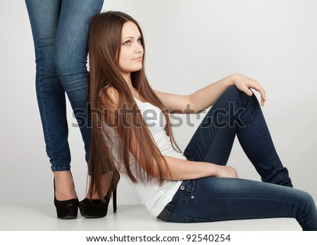girl sitting next to the girls' feet