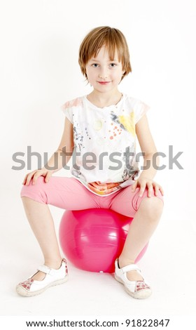 girl sitting on a ball - stock photo