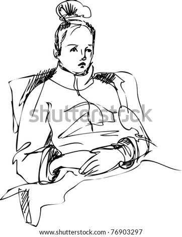 girl sitting on a bed wrapped in a rug