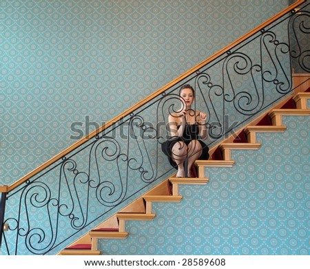 girl sitting on a home stairs - stock photo