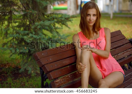 girl sitting on a park bench