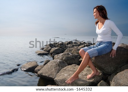 Girl sitting on a rocks-1