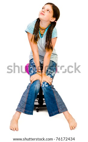 Girl sitting on a stool and day dreaming isolated over white - stock photo