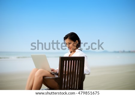 Girl sitting on chair working with laptop