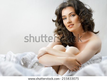 girl sitting on the bed - stock photo