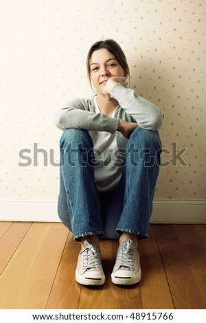 girl sitting on the floor with with vintage effect - stock photo