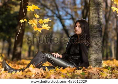 Girl sitting on the ground in the park