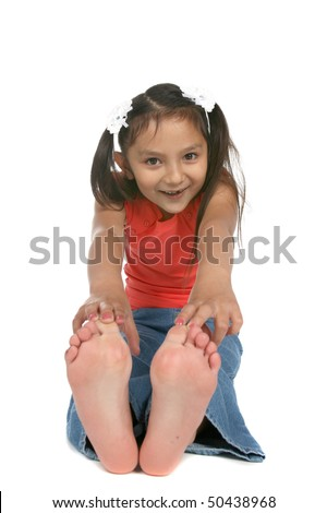 girl sitting with feet out and touching toes