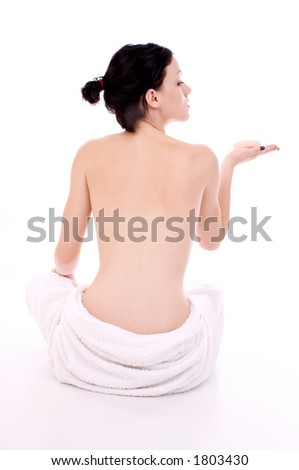 girl sitting with soap in her hand - stock photo