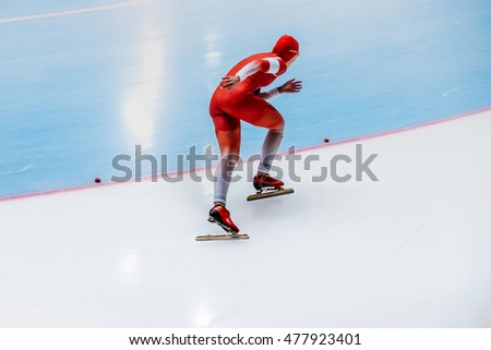 girl skater fast race during a competition in speed skating