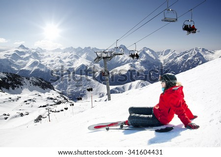 Girl skier lying on snow with ski,  French Alps High mountain