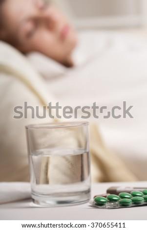 girl sleeping after taking medication - stock photo