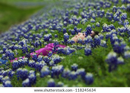Girl Sleeping in Field of Bluebonnets (Closeup with shallow depth of field)