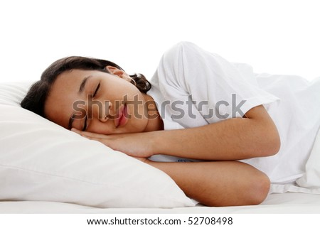Girl sleeping on a pillow in white