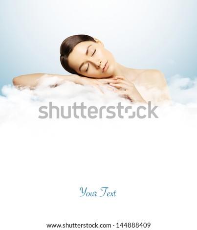 girl sleeping on clouds - stock photo