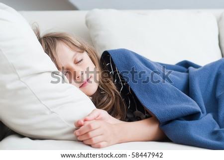 girl sleeps in bed - stock photo
