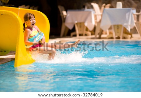 Girl Sliding in pool during Turkey vacations summer holiday - stock photo