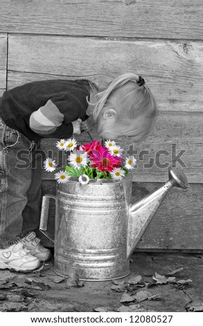 girl smelling spring flowers - stock photo