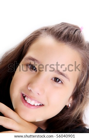Girl smiling and looking at the camera over white background - stock photo