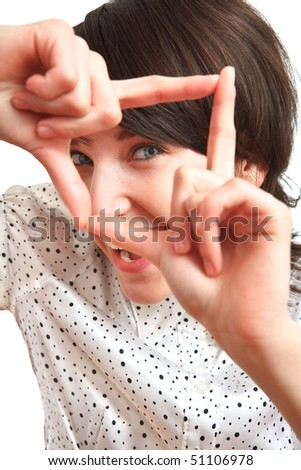 girl smiling and taking a virtual photo with her hands - stock photo