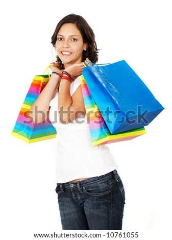 girl smiling carrying shopping bags isolated over a white background