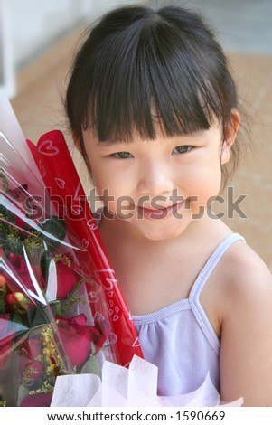 girl smiling & holding bouquet of red roses - stock photo