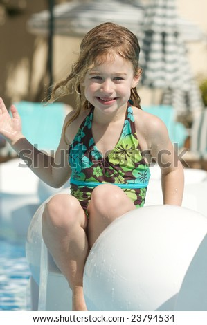 Girl Smiling near a swimming pool on vacation