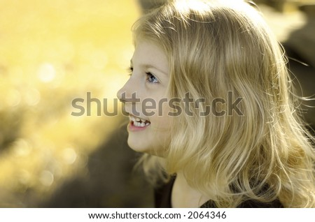 Girl smiling with autumn background - stock photo