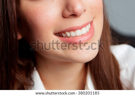 Girl smiling with beautiful white teeth - stock photo