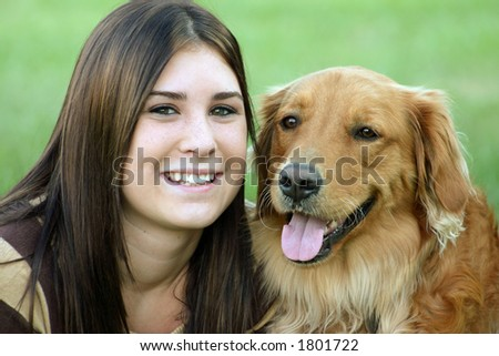 Girl Smiling With Dog - stock photo