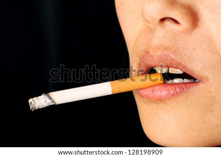 Girl Smoking a Cigarette in close up - stock photo