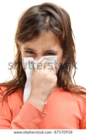 Girl sneezing on a paper tissue isolated on white