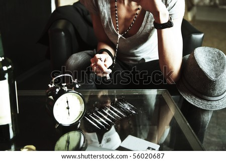 Girl sniffing cocaine with mirrored table - stock photo